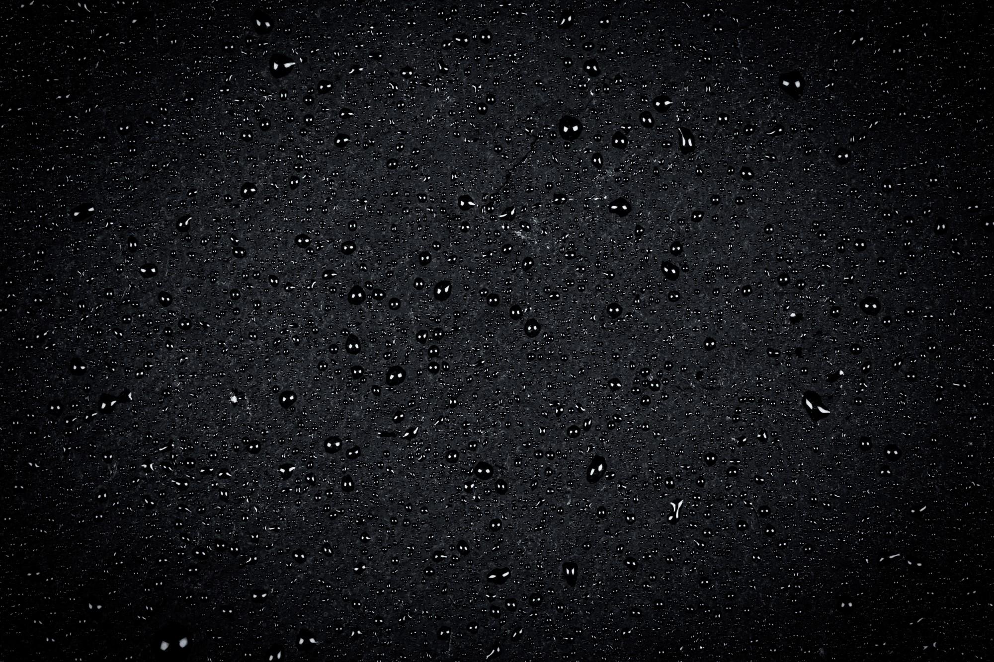 Water drops on dark stone
